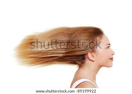 Teen  woman with long blond hairs