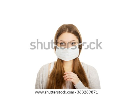 Teen woman with protective mask. - stock photo