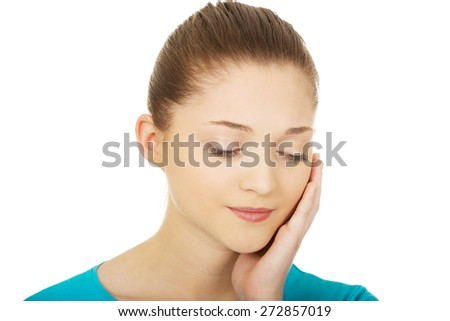Teen woman with toothache touching her face. - stock photo