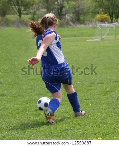 Teen Youth Soccer Player in Action on Field - stock photo