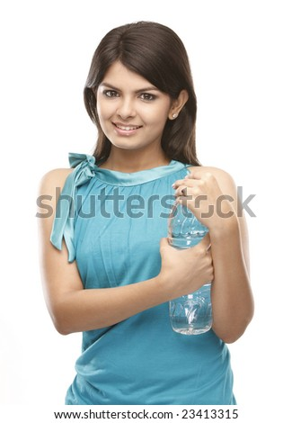 Teenage asian girl holding the water bottle - stock photo