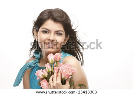 Teenage asian girl with bunch of pink roses - stock photo