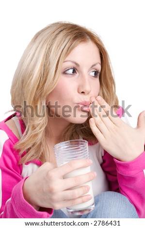 teenage blond girl drinking milk - stock photo