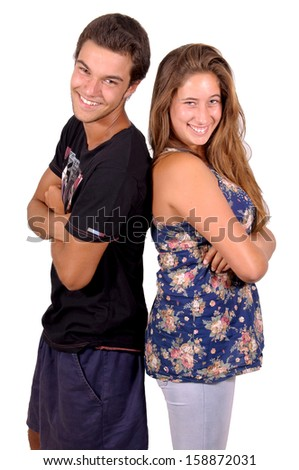 teenage boy and girl posing isolated in white