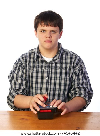 Teenage boy and his video game device - stock photo