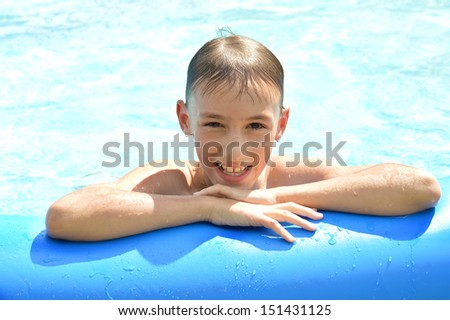 Teenage boy at pool resting after swim