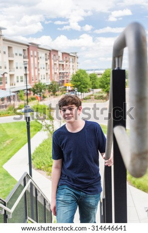 Teenage boy at the lightrail station in urban area.