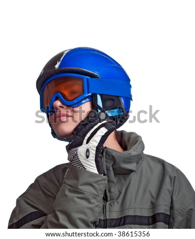 Teenage boy checking his helmet strap before heading down the slope. - stock photo