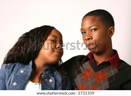 Teenage boy counsels his younger sister with white background - stock photo
