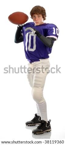 teenage boy dressed up in american football uniform - stock photo