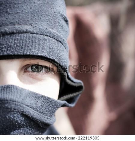 Teenage Boy Face in Balaclava Closeup - stock photo