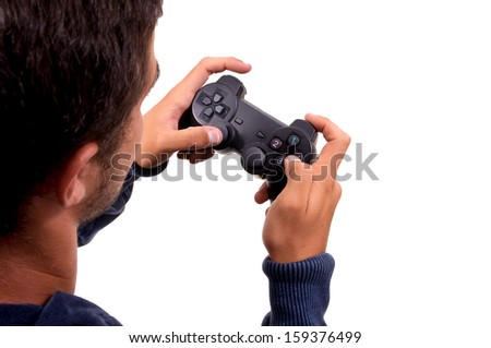teenage boy holding console controller - stock photo