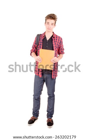 teenage boy holding school books isolated in white - stock photo