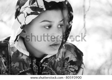 Teenage Boy In Camouflage Clothing - stock photo