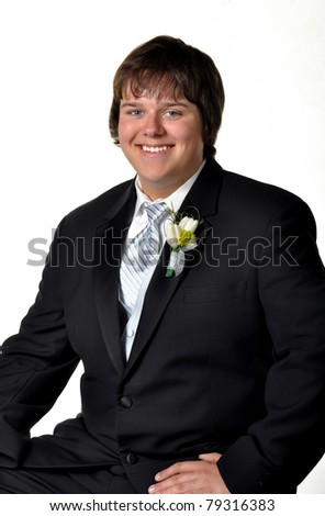 Teenage boy in tux ready for dance on white set - stock photo