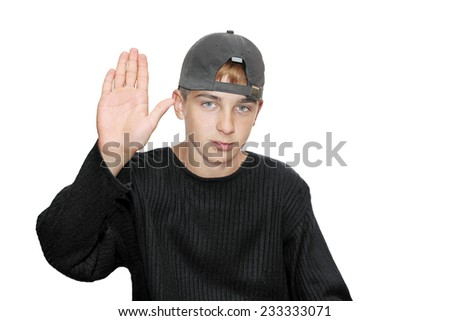 Teenage boy isolated on the white with hand out in stop gesture - stock photo