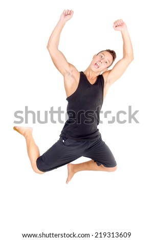 teenage boy jumping isolated in white