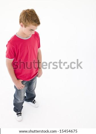 Teenage boy looking down - stock photo