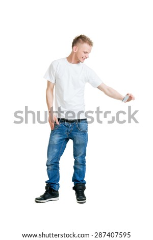 Teenage boy making a selfie isolated on white