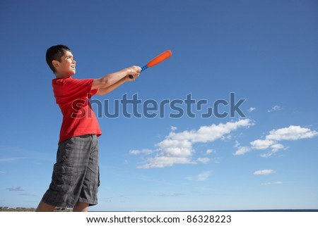 Teenage boy playing baseball - stock photo