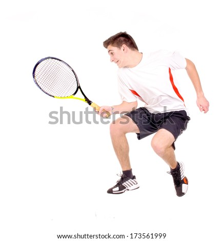 teenage boy playing tennis isolated in white