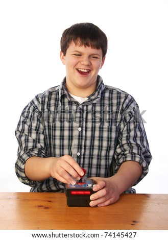 Teenage boy playing video game - stock photo