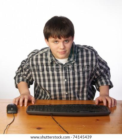 Teenage boy playing video game on computer - stock photo