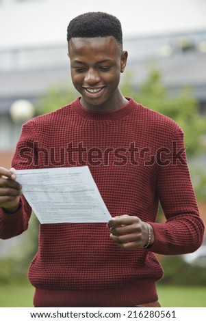 Teenage Boy Pleased With Good Exam Results - stock photo