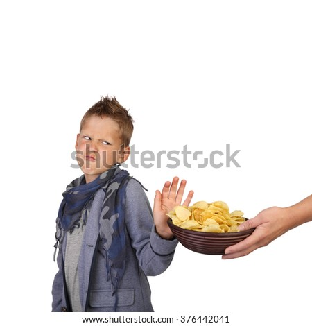 Teenage boy refuses potato chips isolated on white background in square