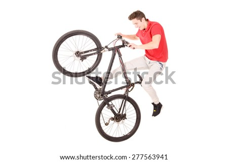teenage boy riding a bicycle isolated in white
