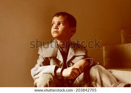 teenage boy setting on stairs - stock photo