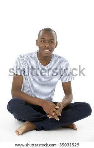 Teenage Boy Sitting In Studio - stock photo