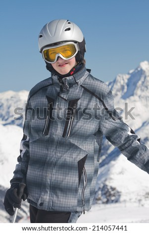 Teenage boy skiing in high mountains - stock photo