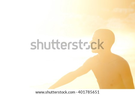 teenage boy skimming at the beach - stock photo