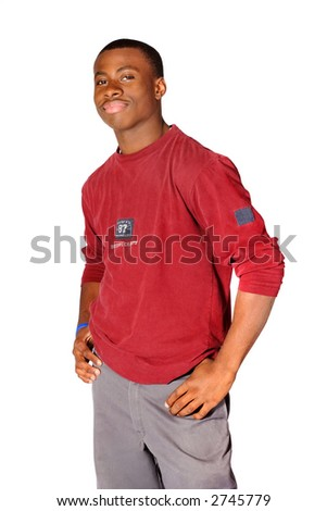 Teenage boy standing with his hands on his hips - stock photo