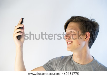 Teenage boy taking a selfie.