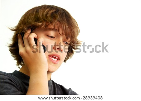 Teenage boy talking on mobile phone isolated on white background. - stock photo
