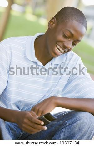 Teenage Boy Texting - stock photo