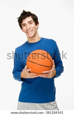 Teenage boy with a basketball - stock photo