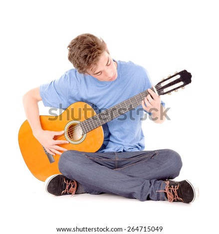 teenage boy with guitar isolated in white - stock photo