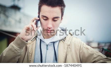 Teenage boy with mobile phone - stock photo