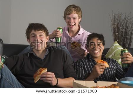 Teenage Boys Eating Pizza - stock photo