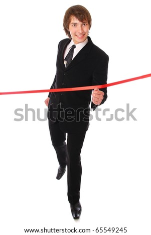 teenage businessman is running through the red line. Isolated at white background - stock photo
