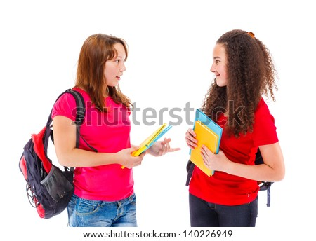 Teenage college students talking to each other - stock photo