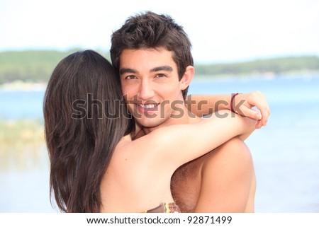 teenage couple at beach - stock photo