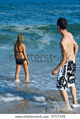 Teenage couple at the beach. - stock photo