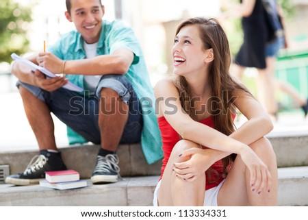 Teenage couple smiling - stock photo
