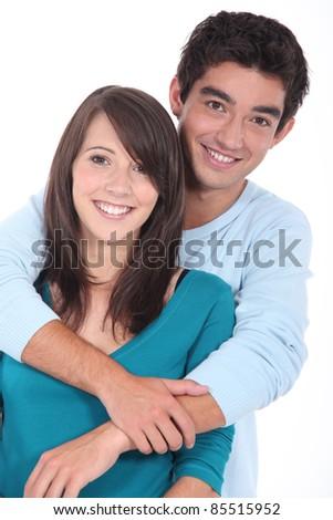 Teenage couple stood in studio - stock photo