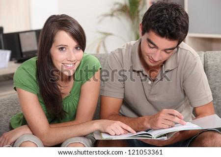 Teenage couple studying - stock photo