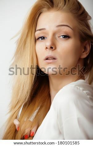 teenage cute blond girl thinking, frustrated, emotional on white background - stock photo